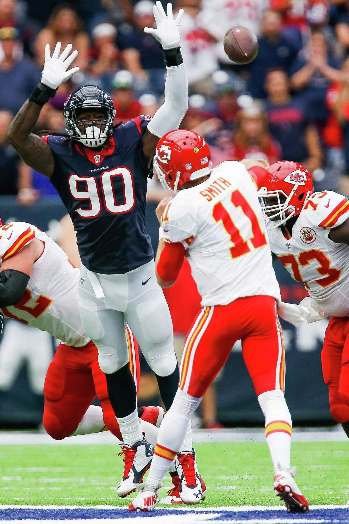 Houston Texans defensive end Jadeveon Clowney (90) attempts to block a pass by Kansas City Chiefs quarterback Alex Smith (11) during the second half of an NFL game at NRG Stadium Sunday, Sept. 18, 2016 in Houston.