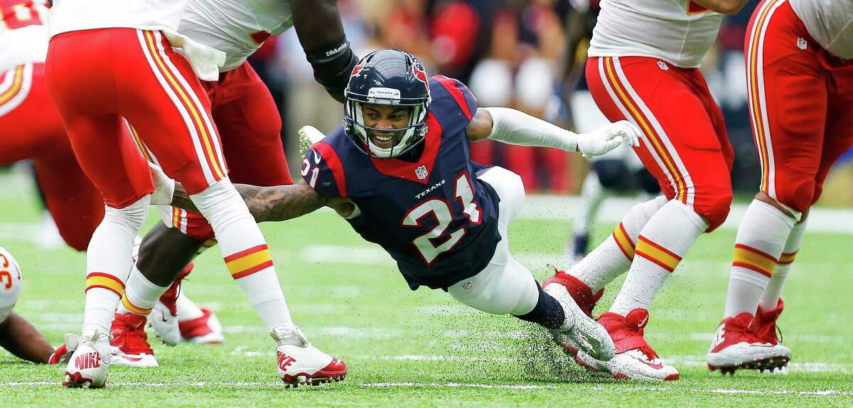 Houston Texans cornerback A.J. Bouye (21) attempts to get to Kansas City Chiefs quarterback Alex Smith (11) during the second half of an NFL game at NRG Stadium Sunday, Sept. 18, 2016 in Houston.