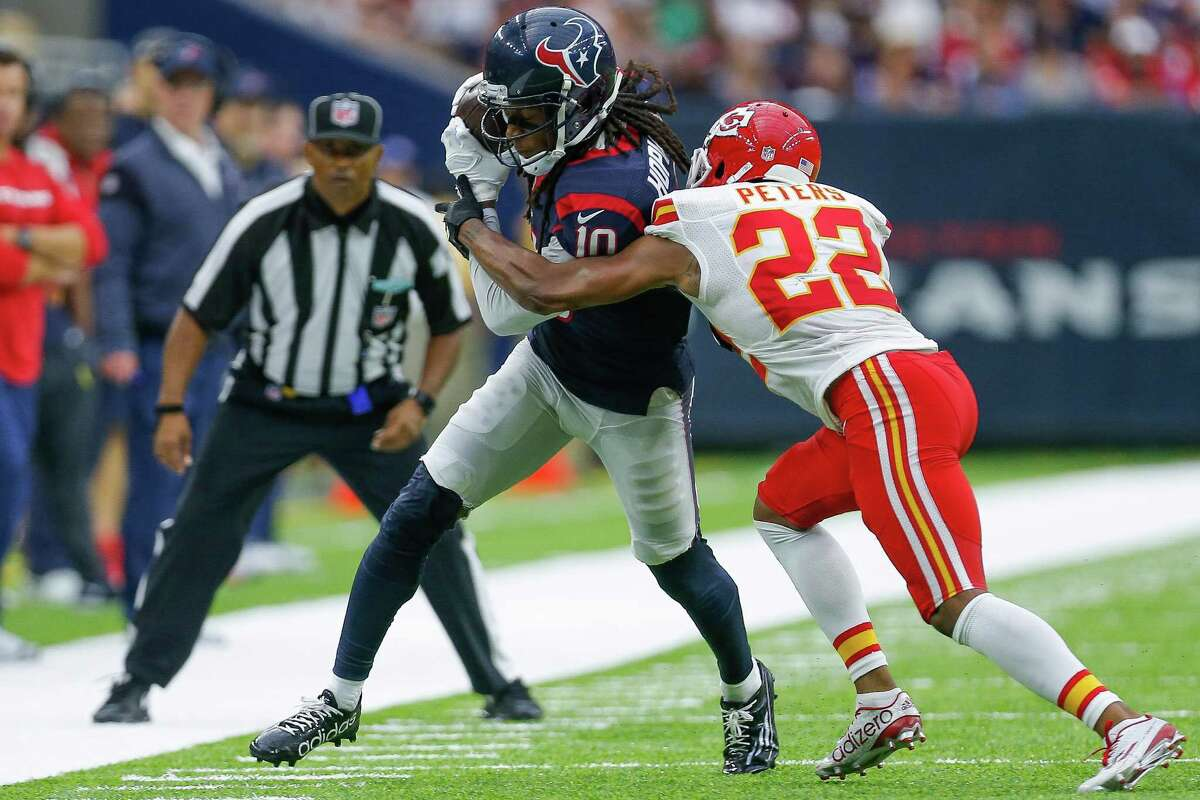 Kansas City Chiefs cornerback Marcus Peters (22) pushes Houston Texans wide receiver DeAndre Hopkins (10) out of bounds after Hopkins made a catch during the second half of an NFL game at NRG Stadium Sunday, Sept. 18, 2016 in Houston.
