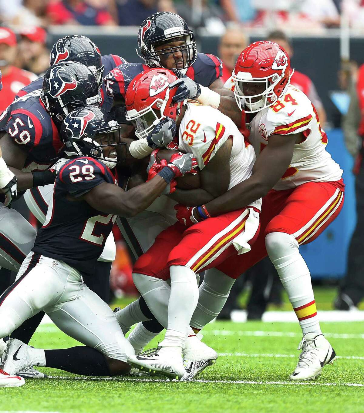 Kansas City Chiefs running back Spencer Ware (32) is surrounded by Houston Texans defense during the third quarter of an NFL football game at NRG Stadium, Sunday, Sept. 18, 2016 in Houston.