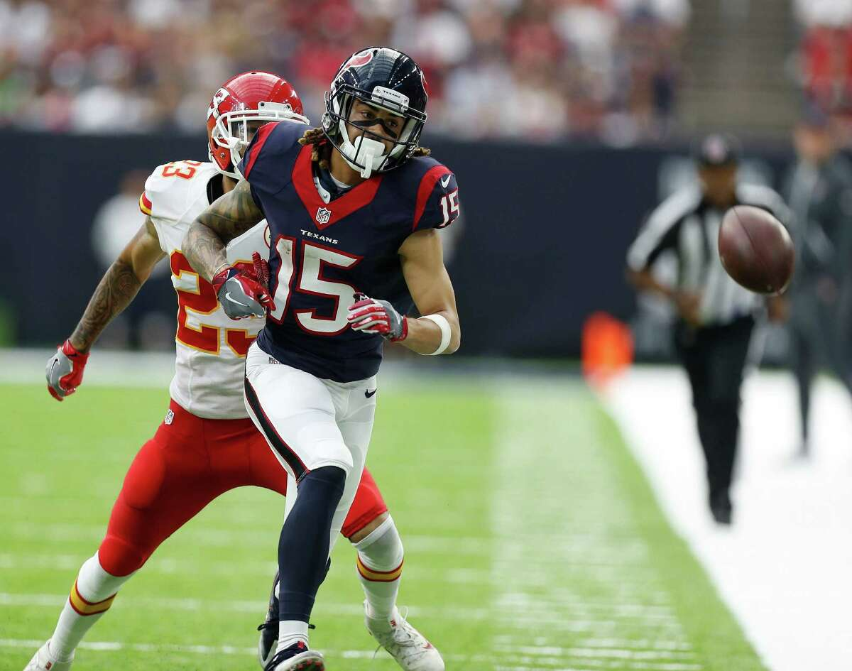 Houston Texans wide receiver Will Fuller (15) watches an over thrown pass go over his head as he was chased by Kansas City Chiefs cornerback Phillip Gaines (23) during the third quarter of an NFL football game at NRG Stadium, Sunday, Sept. 18, 2016 in Houston.