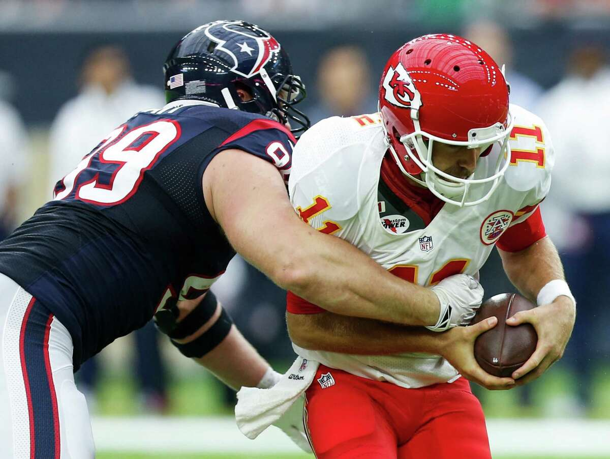 Houston Texans defensive end J.J. Watt (99) sacks Kansas City Chiefs quarterback Alex Smith (11) during the second quarter of an NFL football game at NRG Stadium on Sunday, Sept. 18, 2016, in Houston.