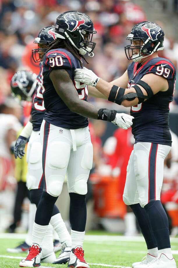 Houston Texans defensive end Jadeveon Clowney (90) will move into the starting lineup spot vacated by J.J. Watt (right) out for the season. Photo: Karen Warren, Houston Chronicle / 2016 Houston Chronicle