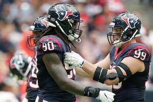Houston Texans defensive end Jadeveon Clowney (90) messes with defensive end J.J. Watt (99) during a time out in the second quarter of an NFL football game at NRG Stadium, Sunday, Sept. 18, 2016 in Houston.