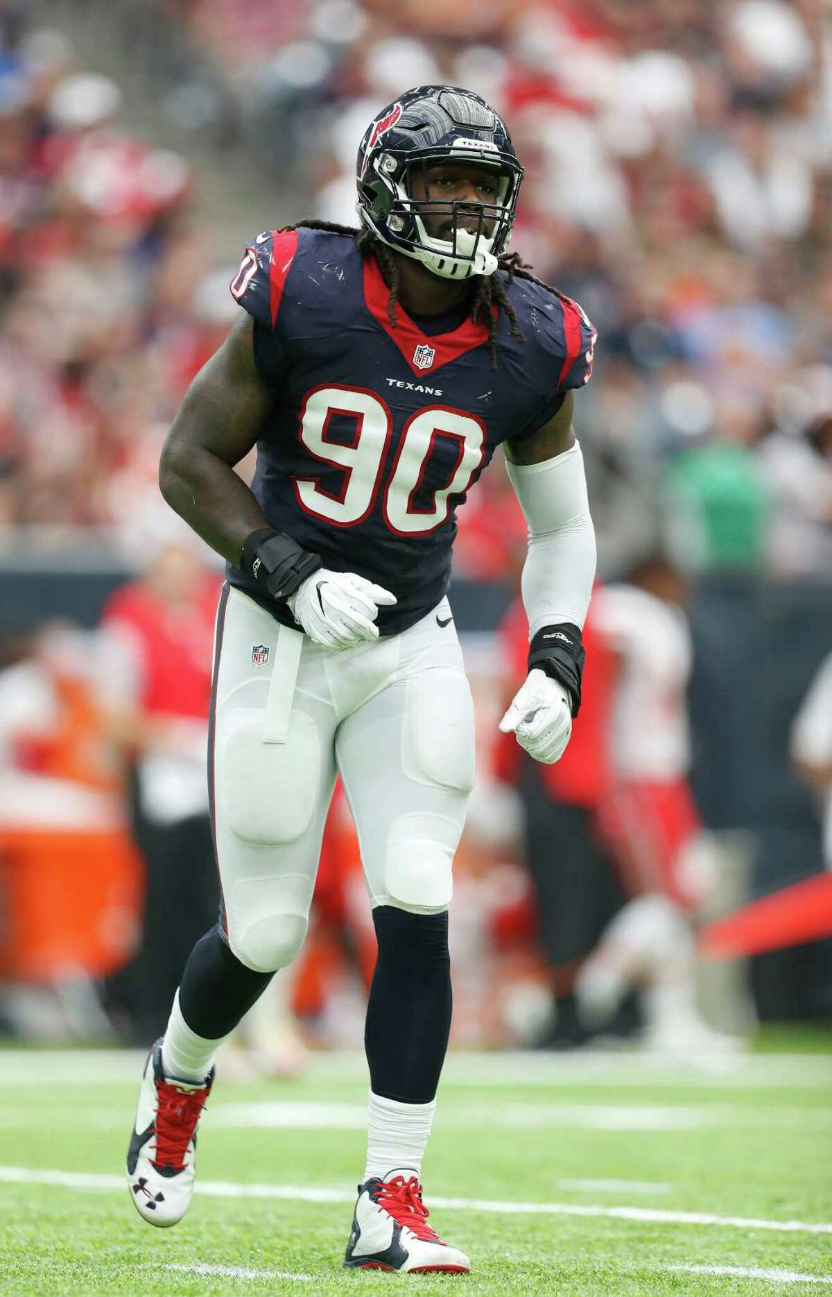 Houston Texans defensive end Jadeveon Clowney (90) gets up slowly after a play during the second quarter of an NFL football game at NRG Stadium, Sunday, Sept. 18, 2016 in Houston.