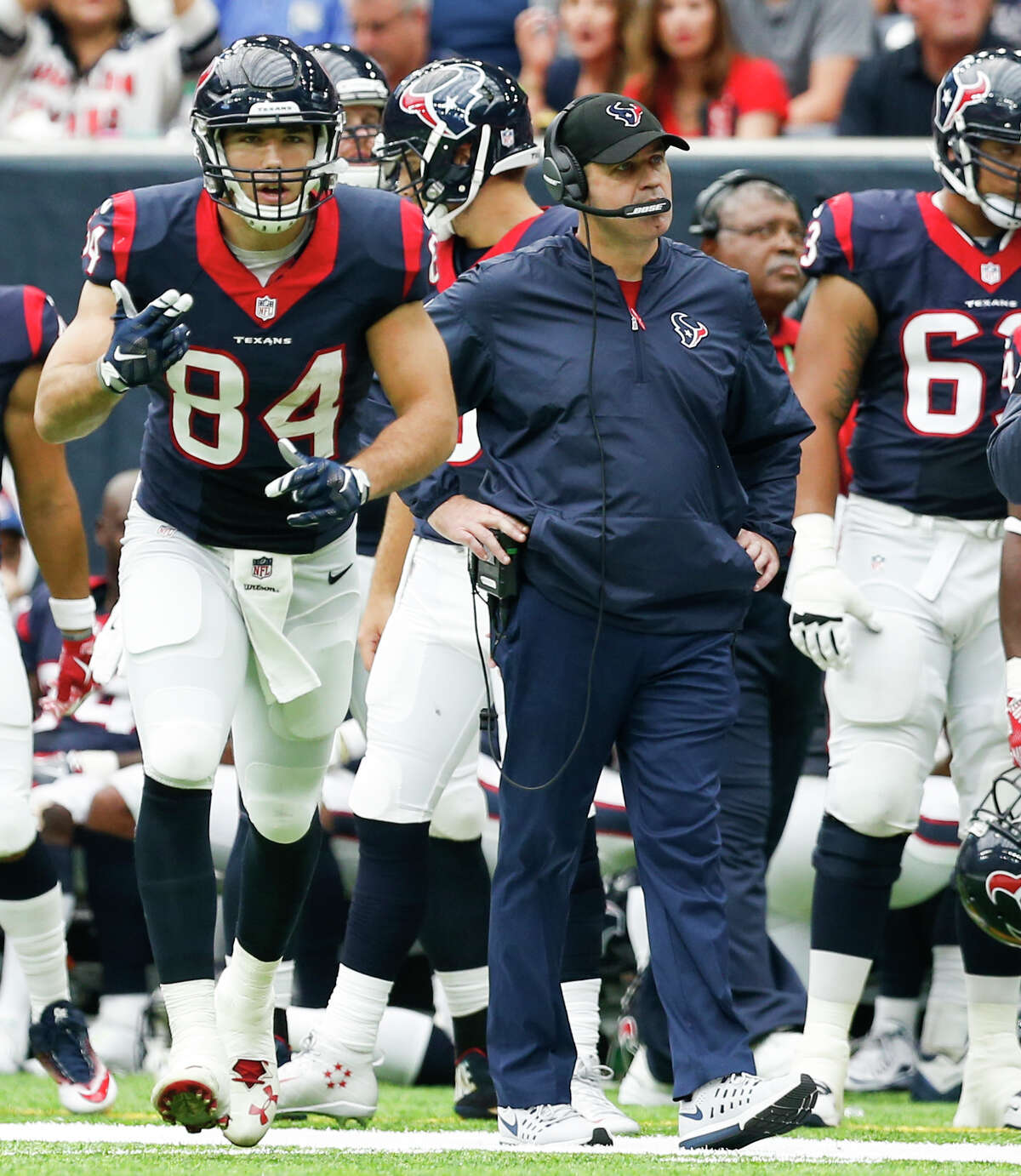 Houston Texans tight end Ryan Griffin (84) runs past head coach Bill O'Brien as he comes into the game during the second quarter of an NFL football game at NRG Stadium on Sunday, Sept. 18, 2016, in Houston.