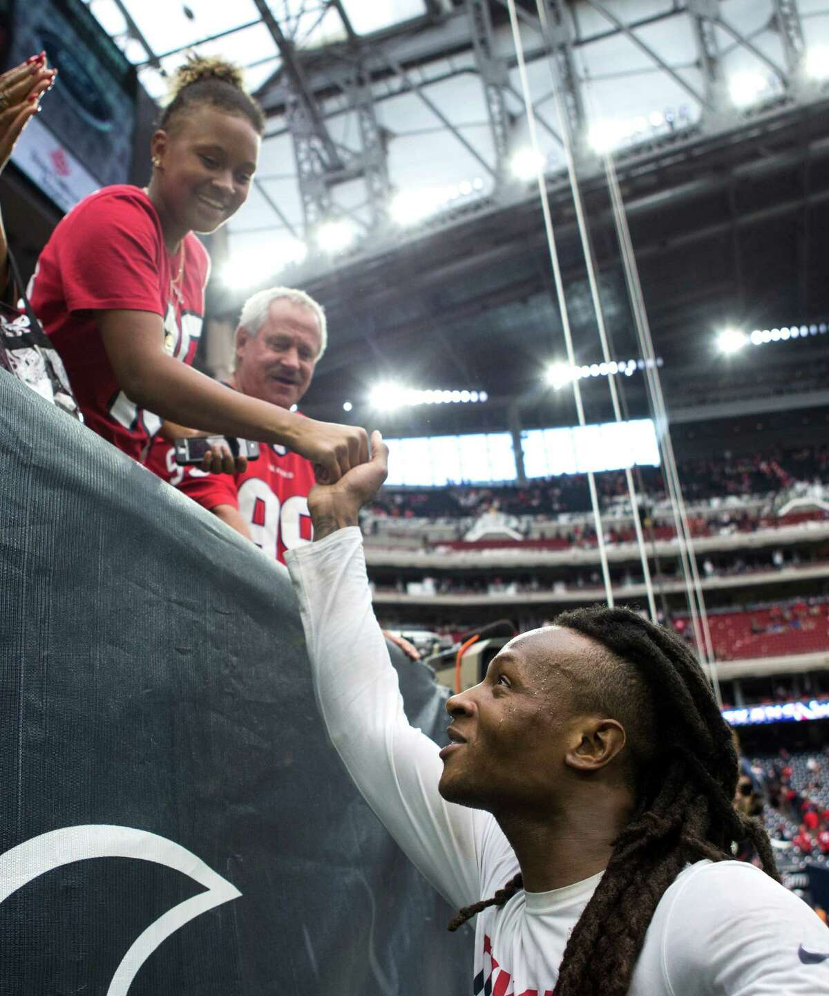 Houston Texans wide receiver DeAndre Hopkins reaches up to a fan after the Texans beat the Kansas City Chiefs 19-12 in an NFL football game at NRG Stadium on Sunday, Sept. 18, 2016, in Houston.