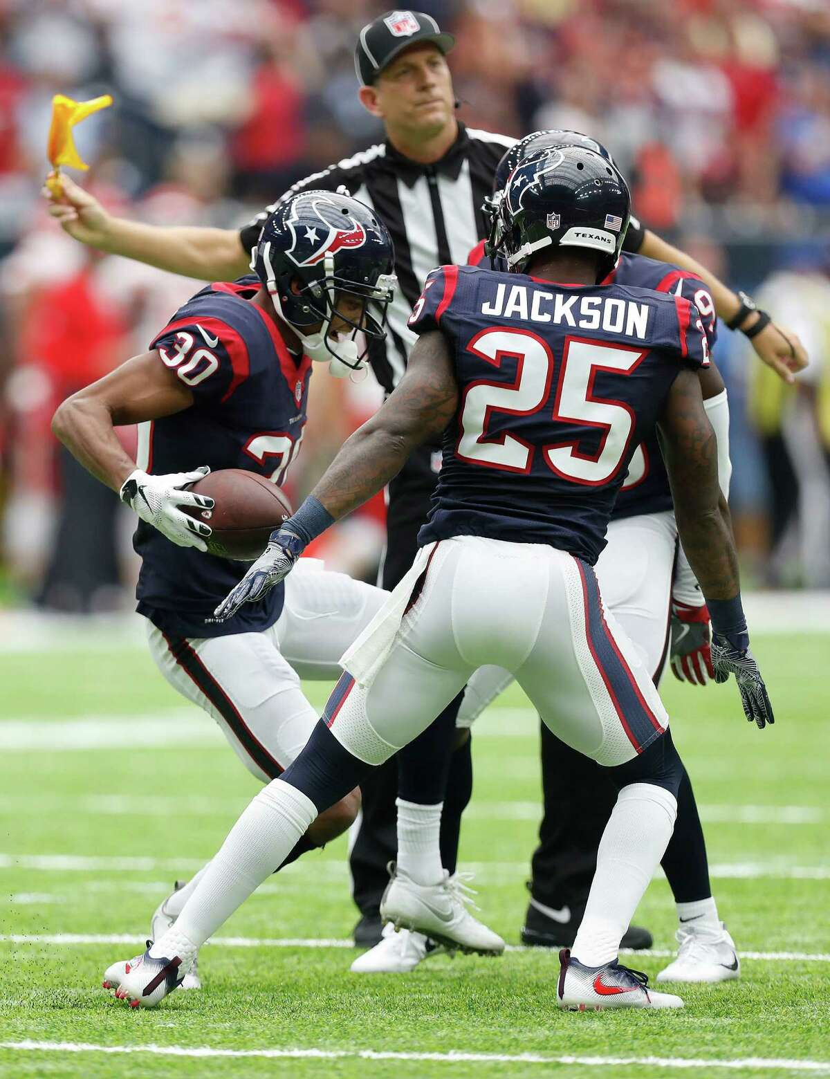 Houston Texans cornerback Kevin Johnson (30) gets called for celebrating after his interception was called back during the first half of an NFL football game at NRG Stadium, Sunday, Sept. 18, 2016 in Houston.