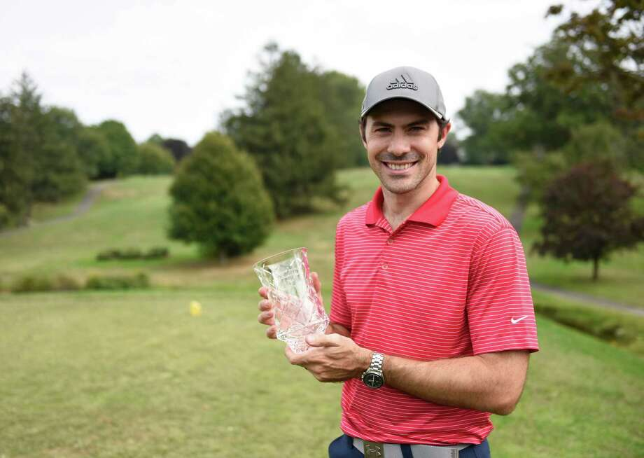 Overall men's champion Fabio Silvagni poses with his championship cup at the Stamford Amateur Golf Championship at the E. Gaynor Brennan Golf Course in Stamford, Conn. Sunday, Sept. 18, 2016. Photo: Tyler Sizemore / Hearst Connecticut Media / Greenwich Time