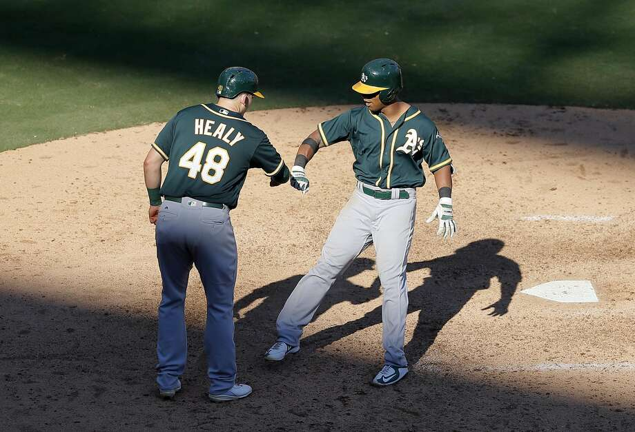 Oakland Athletics' Ryon Healy (48) and Khris Davis, right, celebrate after Davis' two-run home run off a pitch from Texas Rangers' Keone Kela that scored Healy in the eighth inning of a baseball game, Sunday, Sept. 18, 2016, in Arlington, Texas. The shot was Davis' 40th of the season and the second of the game. (AP Photo/Tony Gutierrez) Photo: Tony Gutierrez, Associated Press