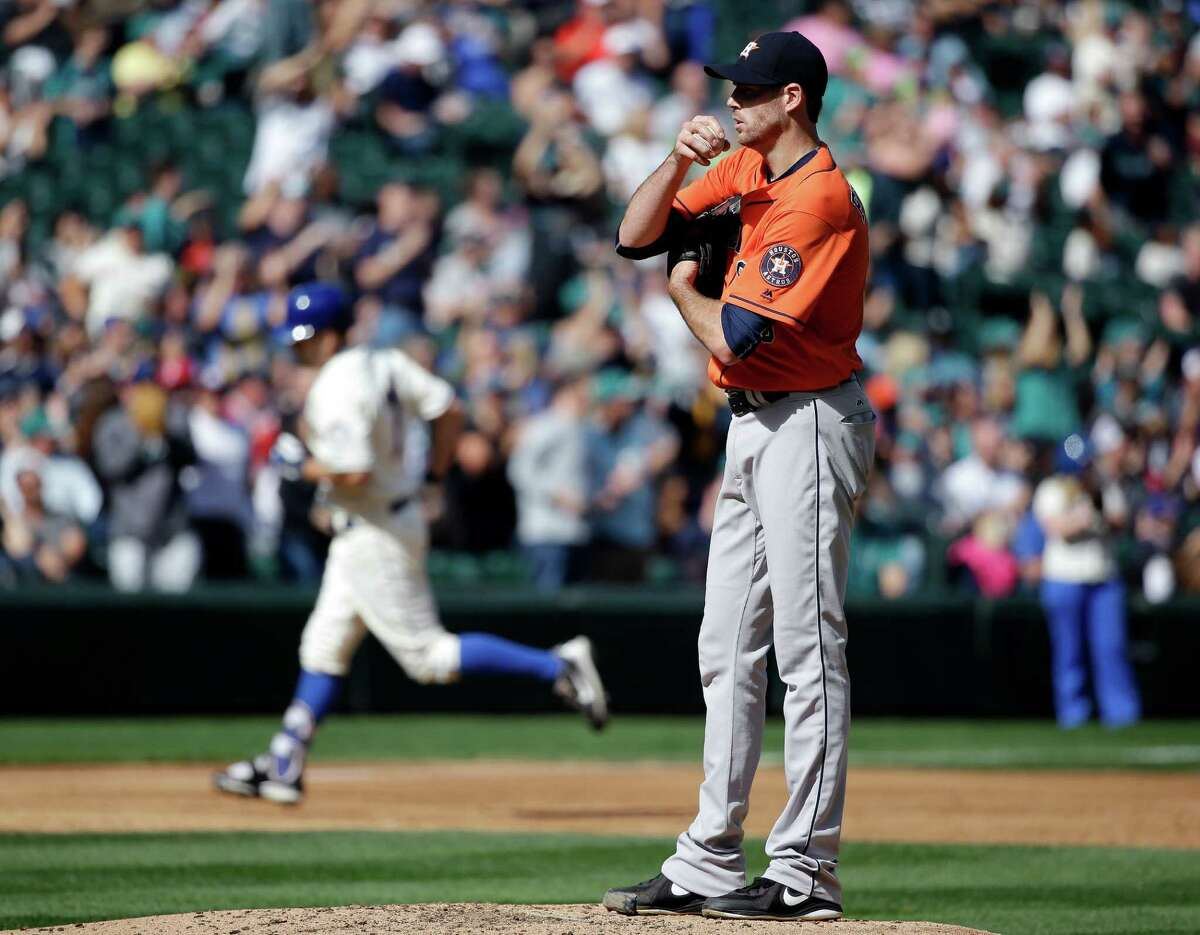 Houston Astros starting pitcher Doug Fister waits for the next batter as Seattle Mariners' Seth Smith rounds the bases after hitting a home run in the third inning of a baseball game, Sunday, Sept. 18, 2016, in Seattle. (AP Photo/Elaine Thompson)