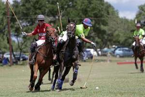 Contestants battle for position on the smaller field as the San Antonio Polo Club hosts the Monterrey Polo Club at the Sagrado Vineyard on September 17, 2016.