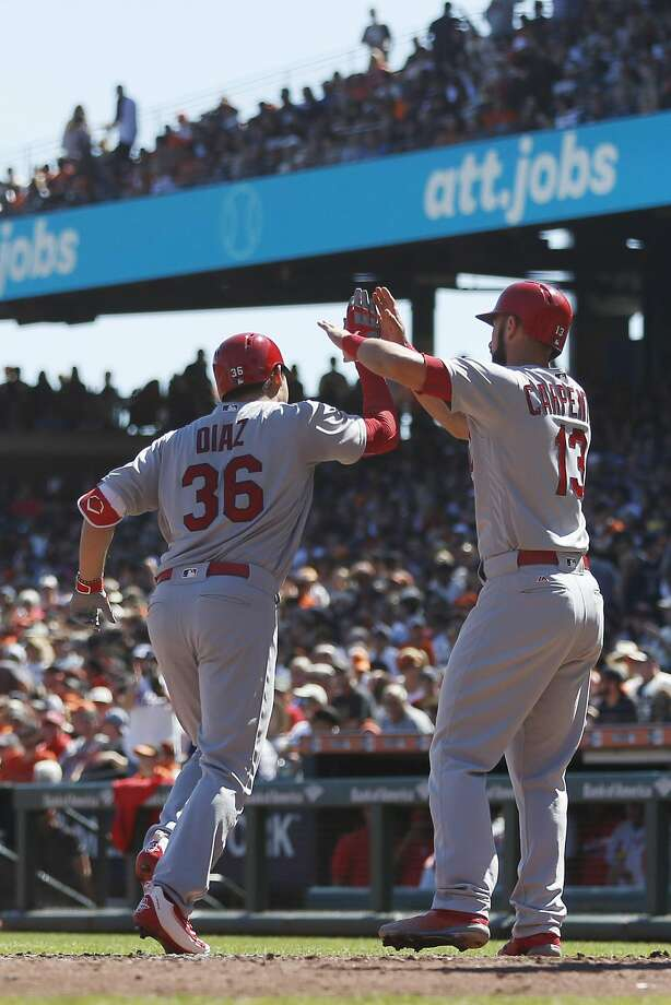 SAN FRANCISCO, CA - SEPTEMBER 18:  Aledmys Diaz #36 of the St. Louis Cardinals is congratulated by teammate Matt Carpenter #13 after hitting a two-run home run during the third inning against the San Francisco Giants at AT&T Park on September 18, 2016 in San Francisco, California. (Photo by Stephen Lam/Getty Images) Photo: Stephen Lam, Getty Images