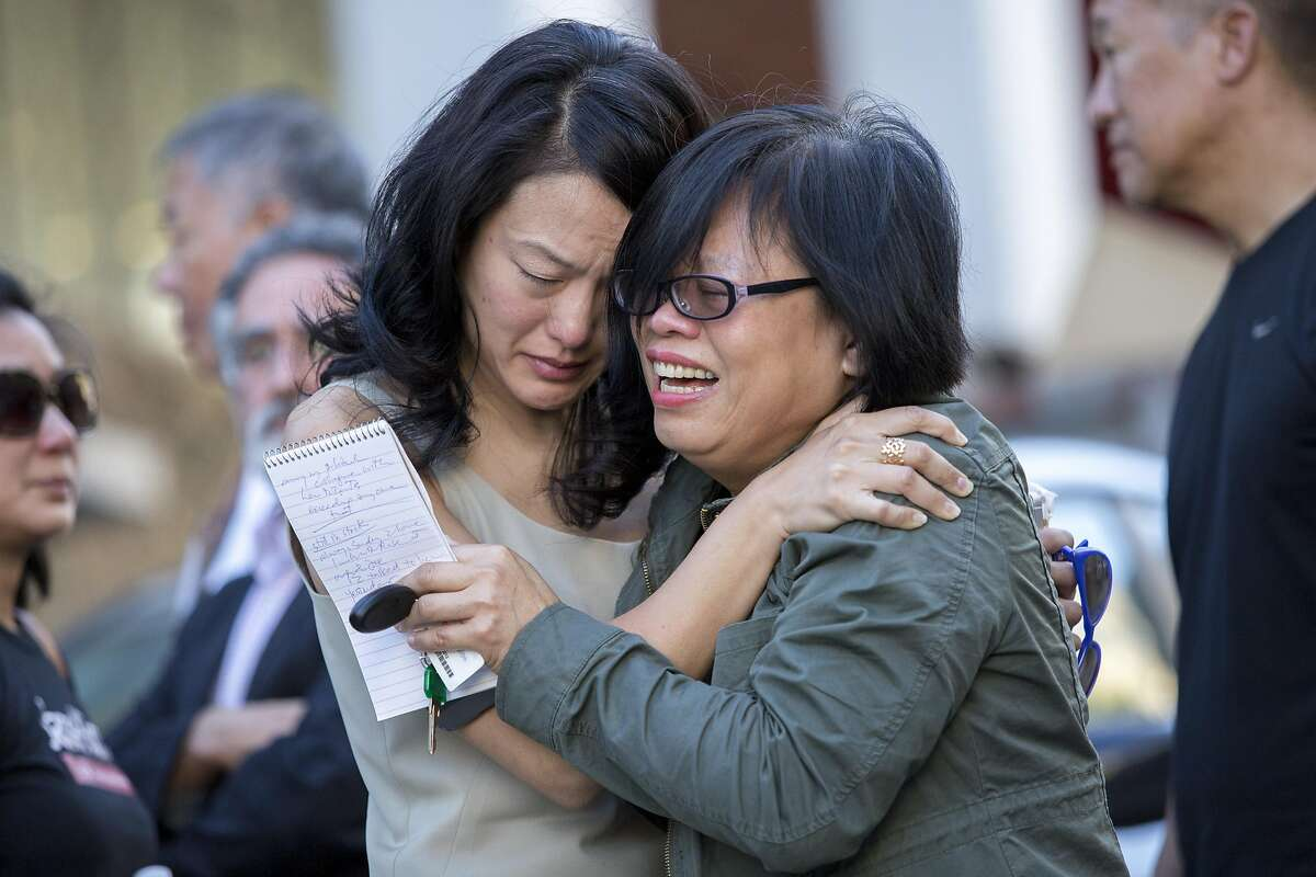 From left: Jane Kim and Portia Li embrace, outside the apartment of Rose Pak, where she died at her Chinatown home, Sunday, Sept. 18, 2016 in San Francisco, Calif.