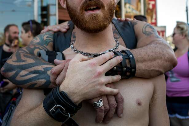 Ruz is embraced by Rot during the national anthem before the LeatherWalk 2016: Kinky Leather Parade on Sunday, Sept. 18, 2016 in San Francisco, Calif.