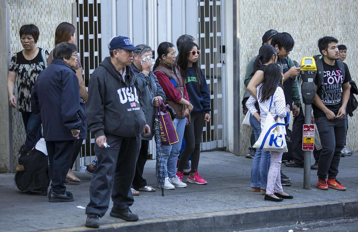 People gather outside the apartment of Rose Pak, where she died at her Chinatown home, Sunday, Sept. 18, 2016 in San Francisco, Calif.