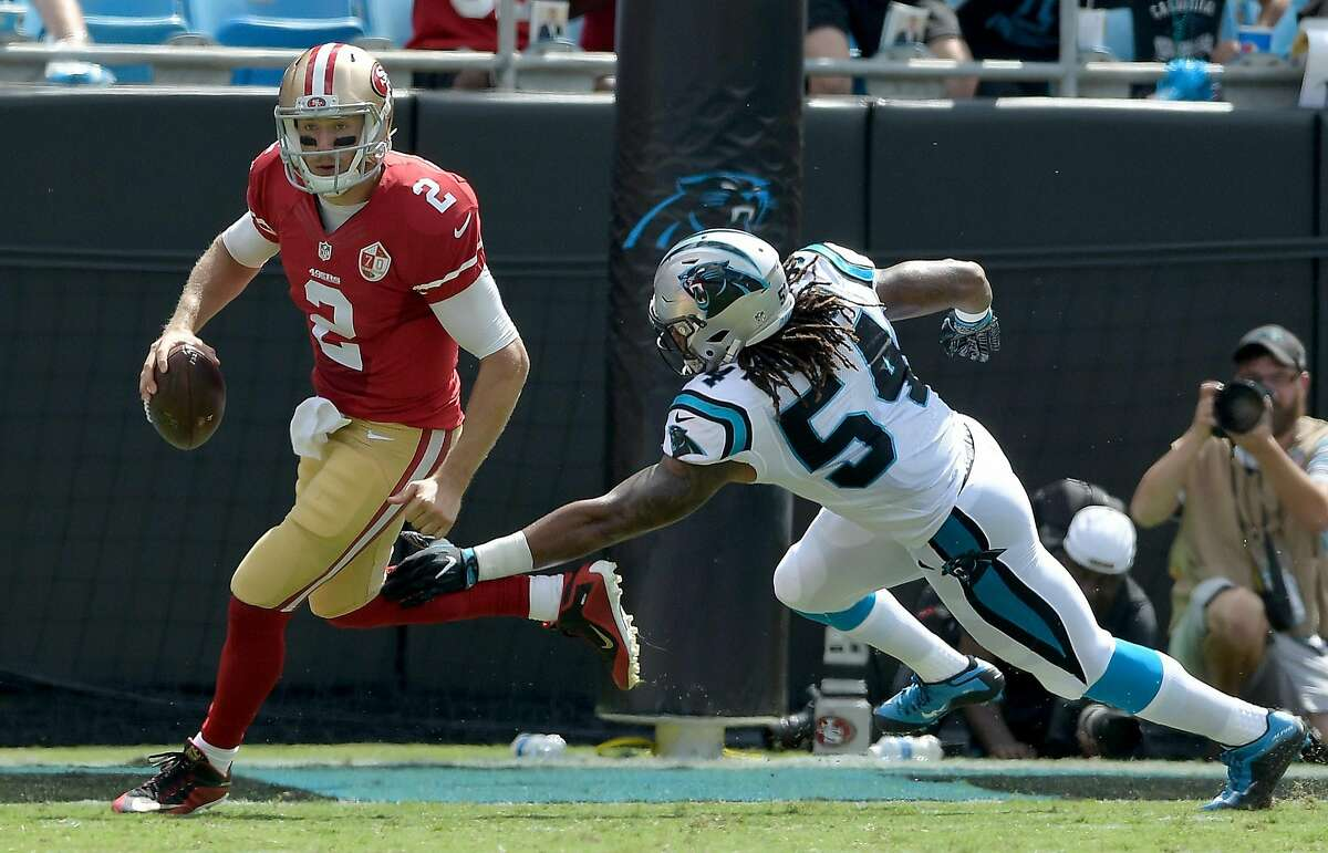 CHARLOTTE, NC - SEPTEMBER 18: Blaine Gabbert #2 of the San Francisco 49ers scrambles from Shaq Thompson #54 of the Carolina Panthers in the 2nd quarter during the game at Bank of America Stadium on September 18, 2016 in Charlotte, North Carolina. (Photo by Grant Halverson/Getty Images)