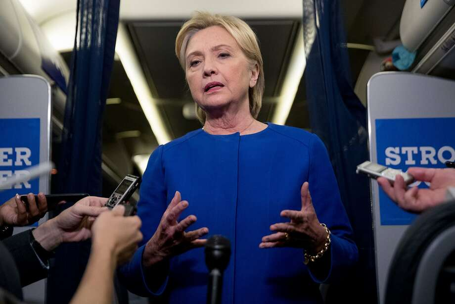 Democratic presidential candidate Hillary Clinton gives remarks on the explosion in Manhattan's Chelsea neighborhood onboard her campaign plane at Westchester County Airport, in White Plains, N.Y., Saturday, Sept. 17, 2016. (AP Photo/Andrew Harnik) Photo: Andrew Harnik, Associated Press