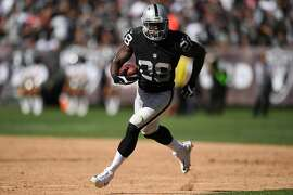 OAKLAND, CA - SEPTEMBER 18:  Latavius Murray #28 of the Oakland Raiders rushes with the ball against the Atlanta Falcons during their NFL game at Oakland-Alameda County Coliseum on September 18, 2016 in Oakland, California.  (Photo by Thearon W. Henderson/Getty Images)