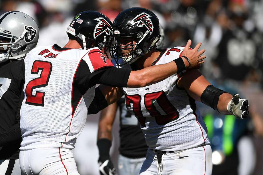 OAKLAND, CA - SEPTEMBER 18:  Matt Ryan #2 of the Atlanta Falcons celebrates with Jake Matthews #70 after a two-point conversion against the Oakland Raiders during their NFL game at Oakland-Alameda County Coliseum on September 18, 2016 in Oakland, California.  (Photo by Thearon W. Henderson/Getty Images) Photo: Thearon W. Henderson, Getty Images