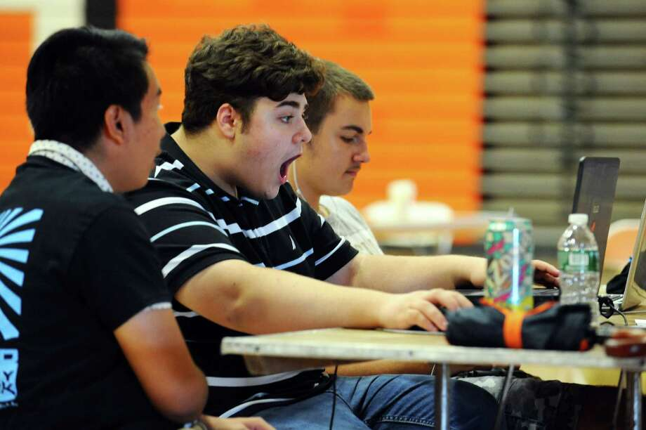 Stamford High School senior Georgios Karakyklas, 16, reacts after fixing a problem with the coding of his team's game during the High School Hackathon inside the Stamford High School gymnasium in Stamford, Conn. on Sunday, September 18, 2016. Photo: Michael Cummo / Hearst Connecticut Media / Stamford Advocate
