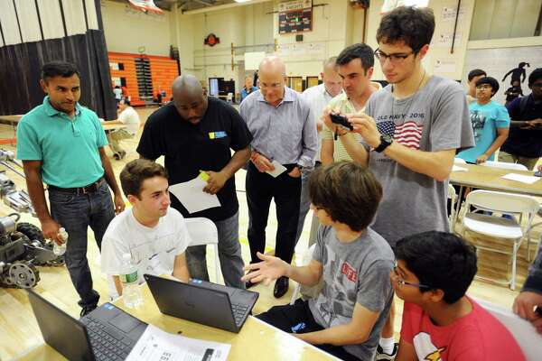 "Westhill seniors Sam Greenberg, right, and Joshua Dampf explain their game ""Mustache Quest"" to the judges during the High School Hackathon inside the Stamford High School gymnasium in Stamford, Conn. on Sunday, September 18, 2016."