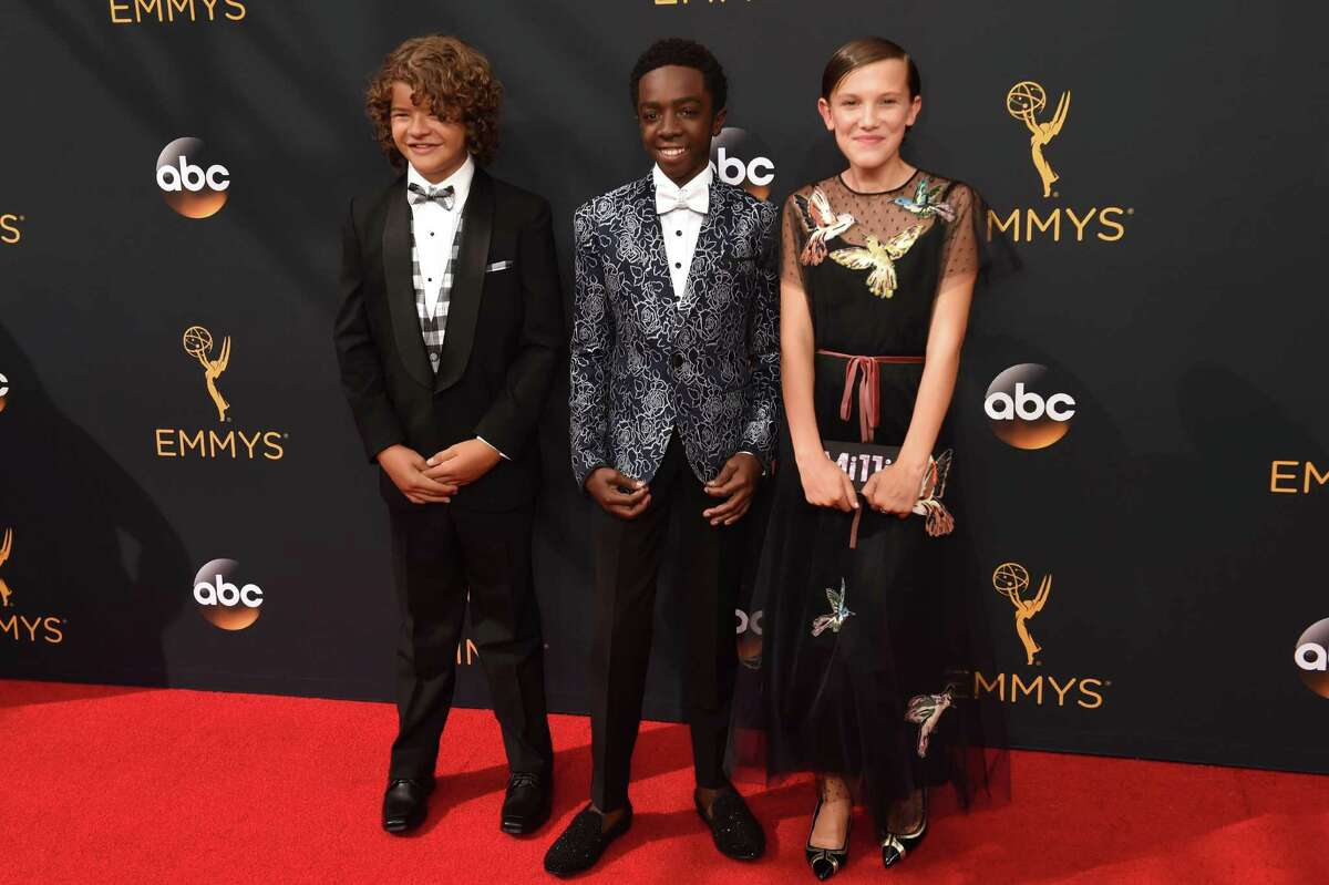 Gaten Matarazzo, Caleb McLaughlin, and Millie Bobby Brown attend the 68th Emmy Awards.