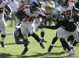 Atlanta Falcons running back Tevin Coleman (26) runs against the Oakland Raiders during the second half of an NFL football game in Oakland, Calif., Sunday, Sept. 18, 2016. (AP Photo/Ben Margot)