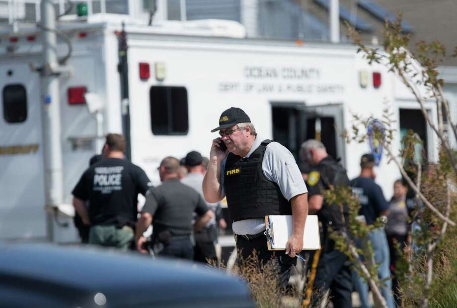 Police gather at a command center in Seaside Park, N.J., on Saturday, Sept. 17, 2016, during an investigation of a pipe bomb which exploded before a charity race to benefit Marines and sailors. No injuries were reported. (Peter Ackerman/The Asbury Park Press via AP) ORG XMIT: NJASB101 Photo: Peter Ackerman / The Asbury Park Press