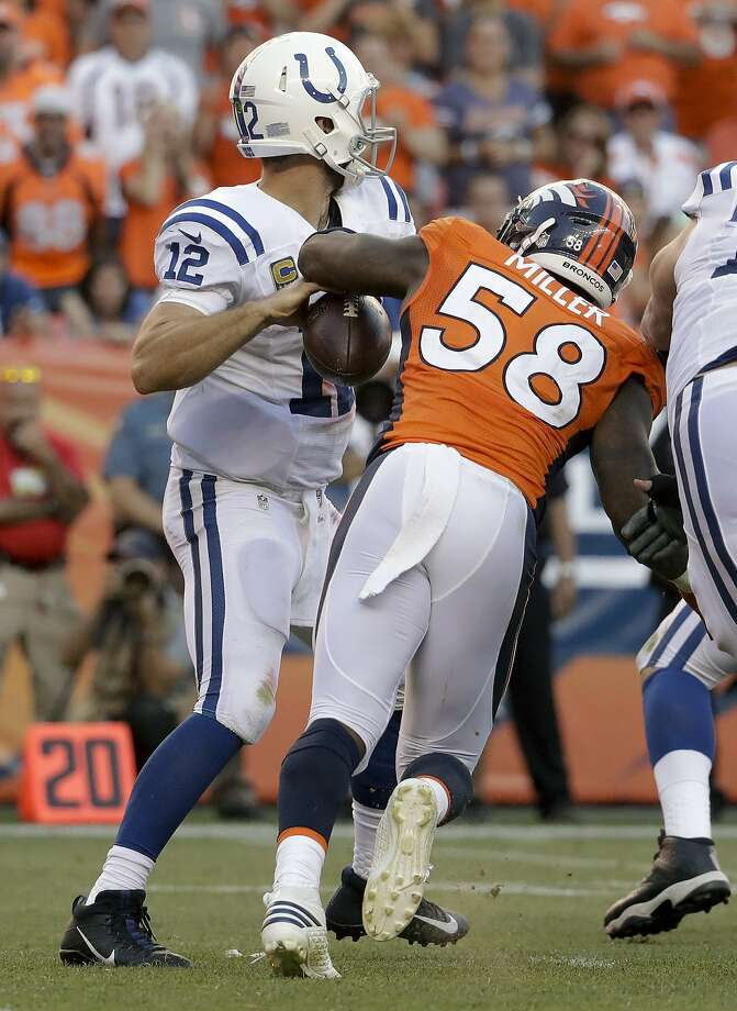 Von Miller forces a fumble from Colts quarterback Andrew Luck in the game's key fourth-quarter play. Photo: Jack Dempsey, Associated Press