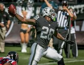 Latavius Murray #28 of the Oakland Raiders spikes the ball after a touchdown against the Flacons at the Oakland-Alameda Coliseum in Oakland, Calif. on September 18th, 2016.