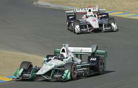 Simon Pagenaud, of France, leads Helio Castroneves (3), of Brazil, through Turn 2 during an IndyCar auto race Sunday, Sept. 18, 2016, in Sonoma, Calif. (AP Photo/Eric Risberg)