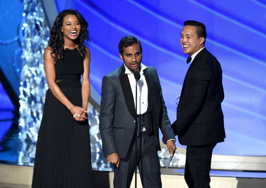 Actor/writer Aziz Ansari (C) and writer Alan Yang (R) accept Outstanding Writing for a Comedy Series for the 'Master of None' episode 'Parents' onstage during the 68th Annual Primetime Emmy Awards at Microsoft Theater on September 18, 2016 in Los Angeles, California. Photo: Kevin Winter/Getty Images