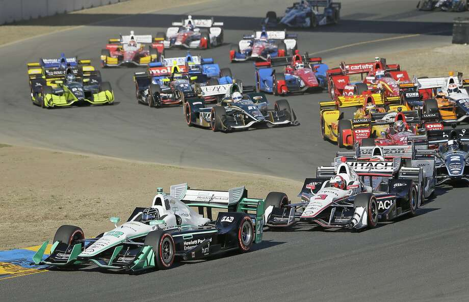 Simon Pagenaud, of France, leads cars through Turn 2 at the start of an IndyCar auto race Sunday, Sept. 18, 2016, in Sonoma, Calif. Helio Castroneves (3), of Brazil, follows Pagenaud. (AP Photo/Eric Risberg) Photo: Eric Risberg, Associated Press