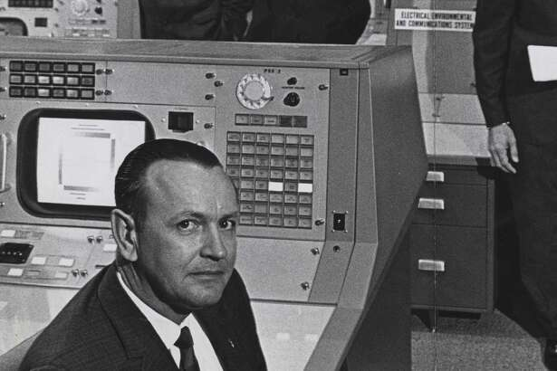 Christopher Kraft, foreground, and colleagues at NASA's Mission Control, from left, John D. Hodge,  Glynn Lunney and Gene Kranz.