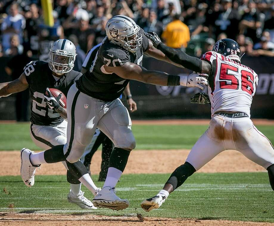 Kelechi Osemele #70 of the Oakland Raiders blocks Sean Weatherspoon #56 of the Atlanta Falcons at the Oakland-Alameda Coliseum in Oakland, Calif. on September 18th, 2016. Photo: John Storey, Special To The Chronicle