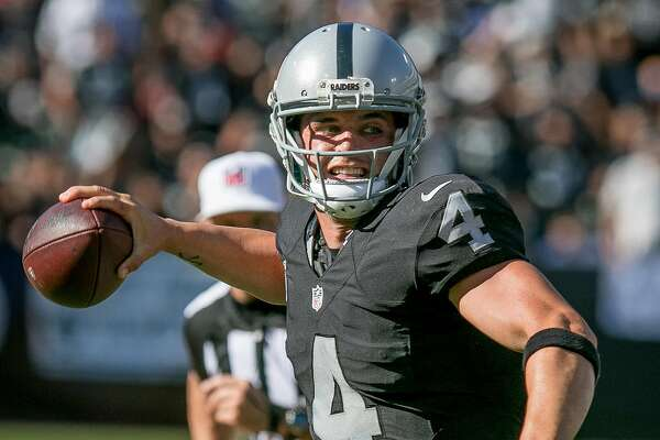 Derek Carr #4 of the Oakland Raiders throws against the Falcons at the Oakland-Alameda Coliseum in Oakland, Calif. on September 18th, 2016.