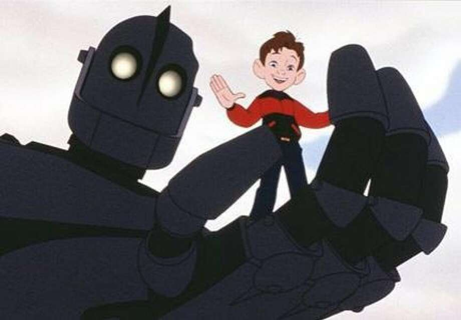 "Hogarth and his new metal friend during happier times in ""The Iron Giant."" Photo: Warner Bros. Animation"
