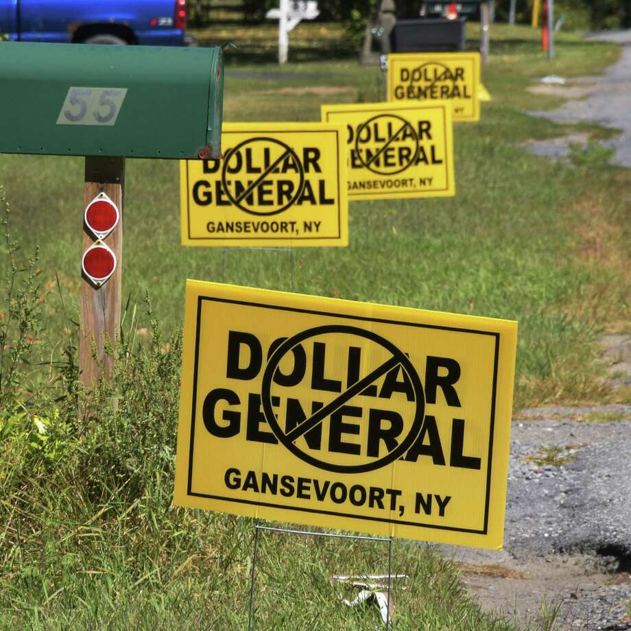 Signs opposing a proposed Dollar General store on Leonard Street Friday Sept. 16, 2016 in Gansevoort, NY.  (John Carl D'Annibale / Times Union) Photo: John Carl D'Annibale / 40038064A