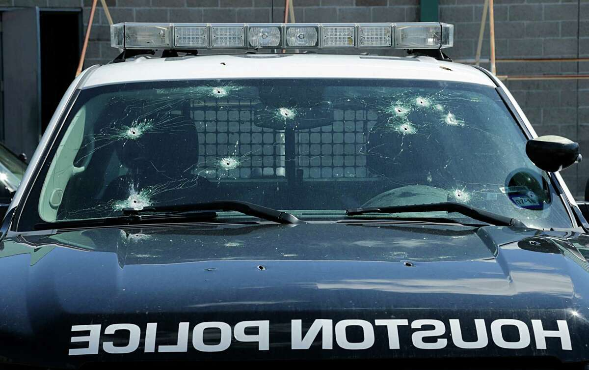 A Houston Police Department out of service vehicle riddle with bullet holes at the Southeast Substation Sept. 15, 2016, in Houston.