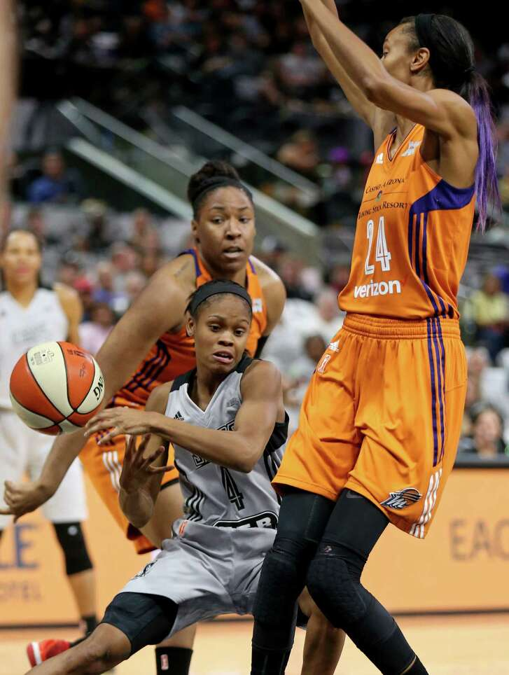 San Antonio Stars' Moriah Jefferson loses control of the ball between Phoenix Mercury's Kelsey Bone (left) and DeWanna Bonner during first half action Sunday Sept. 18, 2016 at the AT&T Center.