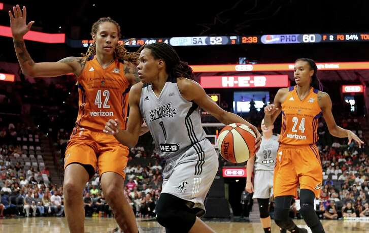 Stars' Monique Currie looks for room around the Phoenix Mercury's Brittney Griner during second half action on Sept. 18, 2016 at the AT&T Center.