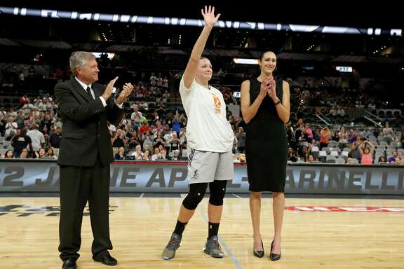 San Antonio Stars head coach Dan Hughes (left) and general manager and former player Ruth Riley (right) applaud for Jayne Appel-Marinelli during her retirement ceremony held after the game with the Phoenix Mercury on Sept. 18, 2016 at the AT&T Center. It was the final game for Hughes and Appel-Marinelli, who both retired.