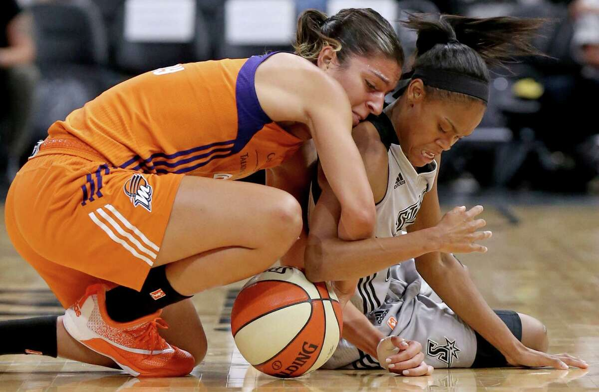 Phoenix Mercury's Marta Xargay and San Antonio Stars' Moriah Jefferson chase after a loose ball during first half action Sunday Sept. 18, 2016 at the AT&T Center.