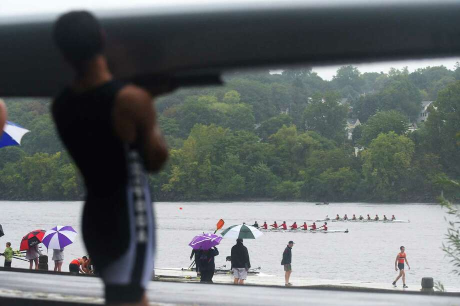 Spectators watch as crew teams head down the Hudson River during the 30th Annual Head of the Hudson Regatta presented by the Schuyler Companies on Sunday, Sept. 18, 2016, in Albany, N.Y.  Over 100 entries from three states competed in the race, which was a timed event.   (Paul Buckowski / Times Union) Photo: PAUL BUCKOWSKI / 40038043A
