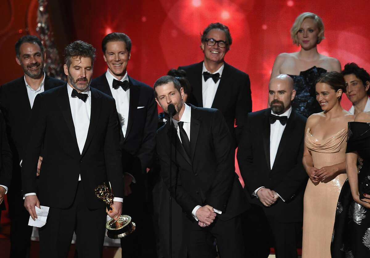 LOS ANGELES, CA - SEPTEMBER 18: Writer/producers David Benioff (2nd L) and D.B. Weiss (C) with cast and production crew accept Outstanding Drama Series for 'Game of Thrones' onstage during the 68th Annual Primetime Emmy Awards at Microsoft Theater on September 18, 2016 in Los Angeles, California. (Photo by Kevin Winter/Getty Images)