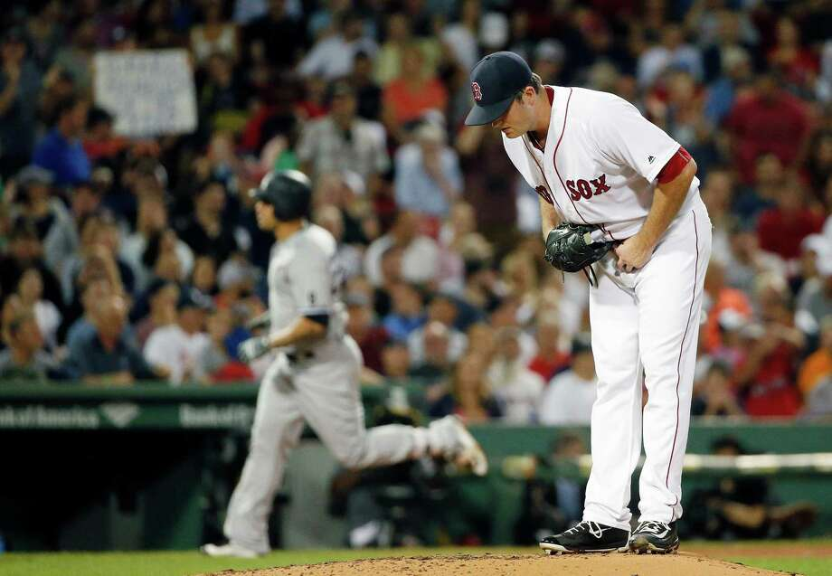 Boston Red Sox's Drew Pomeranz stands on the mound after giving up a solo home run to New York Yankees' Gary Sanchez, left, during the third inning of a baseball game in Boston, Sunday, Sept. 18, 2016. (AP Photo/Michael Dwyer) ORG XMIT: MAMD106 Photo: Michael Dwyer / Copyright 2016 The Associated Press. All rights reserved.