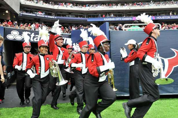 Lamar University marching band members cheer as they run out onto the field Sunday at NRG Stadium in Houston. The band performed during halftime of Sunday's game between the Houston Texans and the Kansas City Chiefs. (Mike Tobias/The Enterprise)