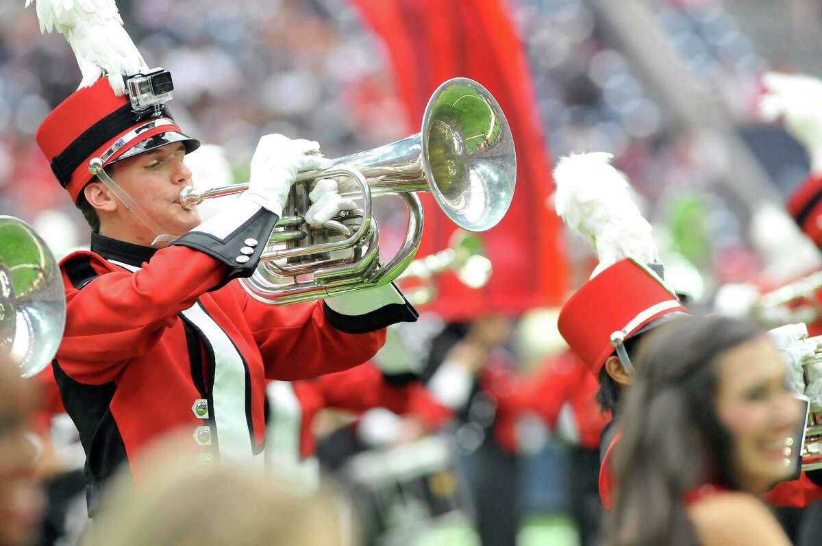 Lamar University marching band members perform during halftime of Sunday's game between the Houston Texans and the Kansas City Chiefs at NRG Stadium in Houston. (Mike Tobias/The Enterprise)