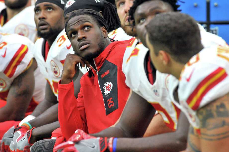Port Arthur Memorial graduate and Kansas City Chiefs running back Jamaal Charles watches a replay on the jumbotron screen during the first quarter Sunday at NRG Stadium in Houston. Charles was listed as inactive hours before kickoff against the Houston Texans. (Mike Tobias/The Enterprise) Photo: Mike Tobias/The Enterprise